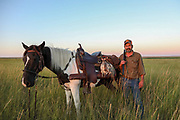 John Zeman, with his horse Buckwheat, and three hard-won Montana sharptailed grouse.