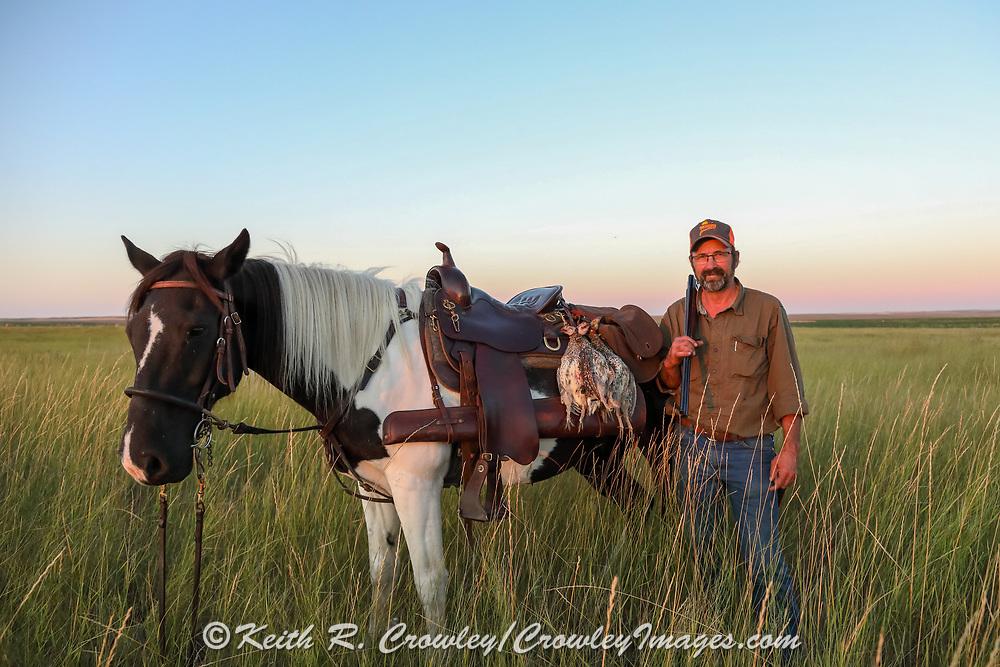John Zeman, with his horse Buckwheat, and three hard-won Montana sharptailed grouse.