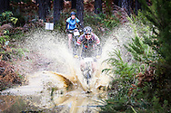 Bernhard Scmidt ploughs through a puddle during day two of the Glacier Storms River Traverse mountain bike stage race held at the The Tsitsikamma Village Inn situated in Storms River Village on the Garden route, South Africa on the 6th August 2016<br /> <br /> Photo by: Oakpics.com / Dryland Event Management / SPORTZPICS<br /> <br /> <br /> {dem16gst}