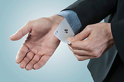Businessman pulling an ace from sleeve, Bavaria, Germany