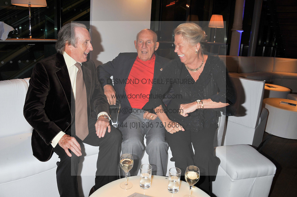 Left to right, SIR JACKIE STEWART and SIR STIRLING & LADY MOSS at the Motor Sport magazine's 2013 Hall of Fame awards at The Royal Opera House, London on 25th February 2013.