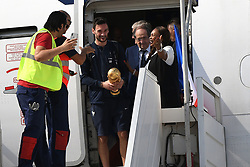 France's goalkeeper Hugo Lloris holds the trophy as he disembarks from the plane next to head coach Didier Deschamps, French Football Federation president Noel Le Graet and Sports Minister Laura Flessel upon their arrival at the Roissy-Charles de Gaulle airport on the outskirts of Paris, France, on July 16, 2018 after winning the Russia 2018 World Cup final football match. Photo by ABACAPRESS.COM