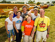 Piper Cub owners at Oshkosh, enjoying a moment of family fun during AirVenture 2012.  Oshkosh, Wisconsin.  <br /> <br /> Created by aviation photographer John Slemp of Aerographs Aviation Photography. Clients include Goodyear Aviation Tires, Phillips 66 Aviation Fuels, Smithsonian Air & Space magazine, and The Lindbergh Foundation.  Specialising in high end commercial aviation photography and the supply of aviation stock photography for advertising, corporate, and editorial use.