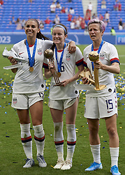 July 7, 2019 - Lyon, France - Alex Morgan silver boot, Rose Lavelle  bronze ball and Megan Rapinoe golden ball and golden boot celebrate after winning the 2019 FIFA Women's World Cup France Final match between The United State of America and The Netherlands at Stade de Lyon on July 7, 2019 in Lyon, France. (Credit Image: © Jose Breton/NurPhoto via ZUMA Press)