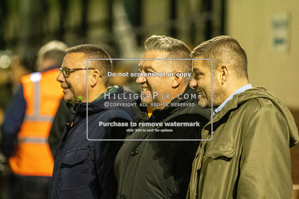 MERSTHAM, UK - OCTOBER 15: David Francis, Vice-Chairman of Cray Wanderers, Gary Hillman, Chairman of Cray Wanderers & Sam Wright, CEO Cray Wanderers, smiling after Cray Wanderers win the BetVictor Isthmian Premier League match between Merstham and Cray Wanderers at The Whisky Bible Stadium on October 15, 2019 in Merstham, UK. <br /> (Photo: Jon Hilliger)