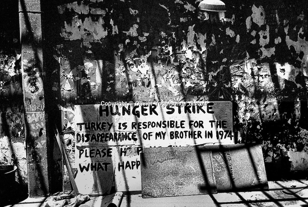 Cyprus. Nicosia. Close to Ledra Palace (a hotel used by United Nations as base) and of the check-point of United Nations, houses carry the stigmates of the war. Graffiti recover walls, posters having served for a demonstration or a strike rest there. And one says to himself that it could serve again tomorrow.