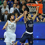 Anadolu Efes's Dogus Balbay (R) and Real Madrid's Sergio Llull (L) during their Turkish Airlines Euroleague Basketball Game 10 match Anadolu Efes between Real Madrid at the Abdi ipekci Arena in Istanbul, Turkey, Thursday, December 19, 2013. Photo by Aykut AKICI/TURKPIX