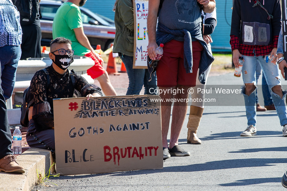 A protester holds an anti-police brutality sign at a  Black Lives Matter rally outside of the police station in Milton, Pennsylvania on September 20, 2020.
