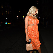 The model and trans activist Monroe Bergdorf celebrate her birthday wearing the orange lace cut out drape midi dress from Pretty Little Thing arrive at Berners Taver on 11 September 2019, London, UK.