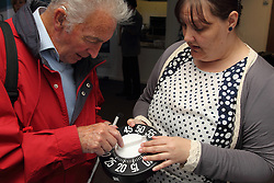 Demonstration of kitchen timer with enlarged numbers at the Mysight charity for people with visual impairments.