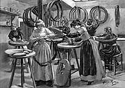 Women making pneumatic tyres for bicycles: France. Wood engraving Paris 1896