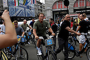 """UK, August 12 2012: Arnold Schwarzenegger on a Barclays """"Boris"""" Bike in Piccadilly Circus on Sunday 12th August 2012. Copyright 2012 Peter Horrell."""
