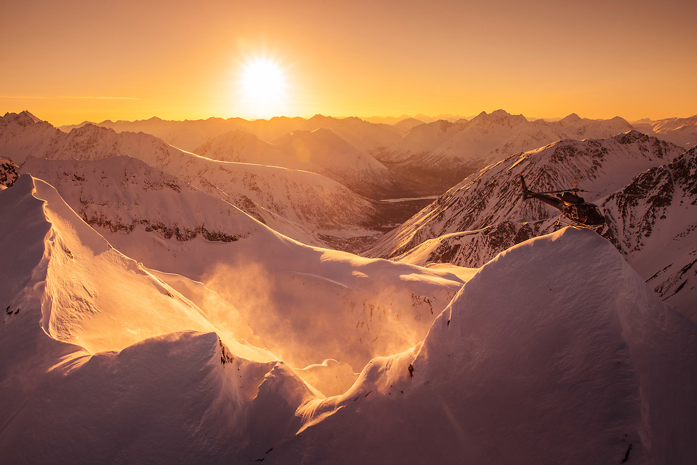 The end of the day in the Alaska mountain range is the best time to be there. A quick stop to evaluate the snow conditions before heading back to the lodge.