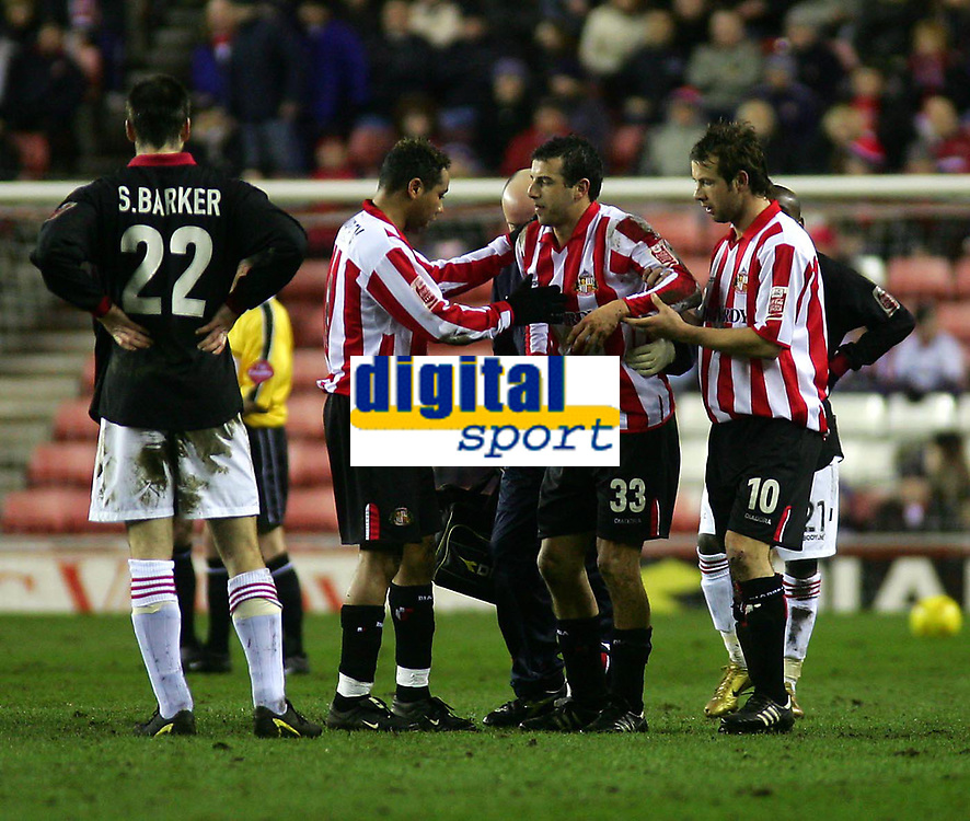 Photo. Andrew Unwin.<br /> Sunderland v Rotherham, Coca-Cola Championship, Stadium of Light, Sunderland 22/02/2005.<br /> Sunderland's Julio Arca (#33) is helped to his feet as he prepares to limp off the field with an injury that he tried, but failed, to play through.
