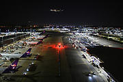 55819 Memphis, Tenn. - Airplanes make their way into the FedEx World hub in Memphis for unloading and sorting before heading to their final destination. <br /> <br /> CREDIT: William DeShazer for The Wall Street Journal