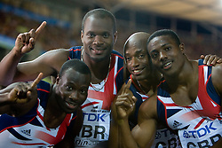 (L-R) Tyrone Edgar, Simeon Williamson,  Marlon Devonish and Harry Aikines-Aryeete celebrate winning the bronze medal in the mens 4x100 Metres Relay Final during day eight of the 12th IAAF World Athletics Championships at the Olympic Stadium on August 22, 2009 in Berlin, Germany. (Photo by Vid Ponikvar / Sportida)