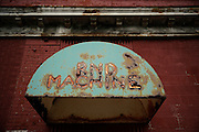 SHOT 7/8/14 1:01:37 PM - Rusting signage for the closed RND Machine shop in Buffalo, N.Y. RND was a machine shop providing general & CNC machining, drilling & boring, lathe & mill work. Buffalo, N.Y. is the second most populous city in the state of New York. Located in Western New York on the eastern shores of Lake Erie and at the head of the Niagara River across from Fort Erie, Ontario, Canada, Buffalo is the seat of Erie County and the principal city of the Buffalo-Niagara Falls metropolitan area, the largest in Upstate New York. By 1900, Buffalo was the 8th largest city in the country, and went on to become a major railroad hub, the largest grain-milling center in the country and the home of the largest steel-making operation in the world. The latter part of the 20th Century saw a reversal of fortunes: by the year 1990 the city had fallen back below its 1900 population levels. (Photo by Marc Piscotty / © 2014)