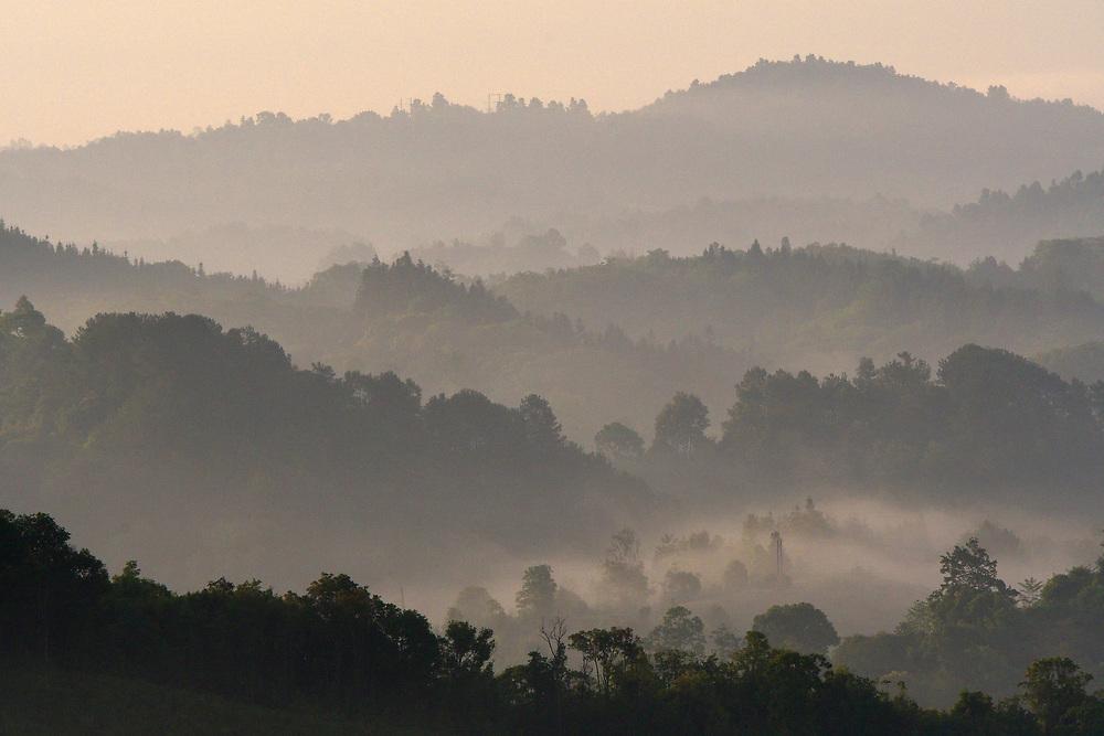 Morning fogs over Tongbiguan nature reserve, Dehong prefecture, Yunnan province, China
