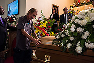 Antonio Basco touches the casket of his wife Margie Reckard, 63, at the La Paz Faith Memorial & Spiritual Center in El Paso, Texas, Friday, August 16, 2019. Reckard was among the 23 people killed in the Aug. 3 mass shooting at the Cielo Vista Walmart in El Paso.