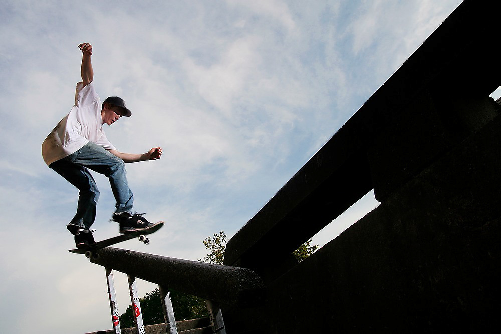 Trevor Fenner grinds a handrail on his skateboard during a session on the angular concrete features by Garfield High School, in Seattle, Washington on July 12, 2007. Fenner, who grew up in Seattle, now lives in Los Angeles and came back for the summer to look for work.
