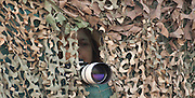 A researcher and camera are seen hidden behind a camouflaged bird hide used by birdwatchers. Photographed in Ein Afek Nature Reserve, Israel in September