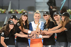 May 13, 2017 - Madrid, Spain - SIMONA HALEP of Romania poses with the ballgirls after winning  the Mutua Madrid Open tennis tournament. (Credit Image: © Christopher Levy via ZUMA Wire)