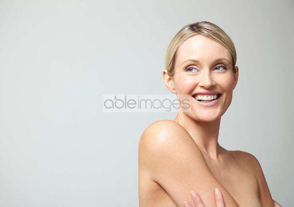 Smiling Woman with Hair Pulled Back