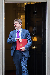 © Licensed to London News Pictures. 25/10/2016. London, UK. Secretary of State for Business, Energy and Industrial Strategy Greg Clark leaves Downing Street after the government sub-committee on airports, which is expected to green light the construction of a third runway at Heathrow airport. Photo credit: Rob Pinney/LNP