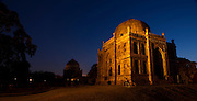 "12th October 2011,New Delhi, India. The Sheesh Gumbad  (""Glass dome"") monument floodlit in the early evening in Lodi Gardens, New Delhi<br /> <br /> Lodi Gardens is a park in Delhi, India. Spread over 90 acres. It contains, Mohammed Shah's Tomb, Sikander Lodi's Tomb, Sheesh Gumbad and Bara Gumbad, architectural works of the 15th century Sayyid and Lodis, a Pashtun dynasty which ruled much of Northern India during the 16th century, and the site is now protected by the Archeological Survey of India (ASI).<br /> PHOTOGRAPH BY AND COPYRIGHT OF SIMON DE TREY-WHITE<br /> <br /> + 91 98103 99809<br /> + 91 11 435 06980<br /> +44 07966 405896<br /> +44 1963 220 745<br /> email: simon@simondetreywhite.com photographer in delhi"