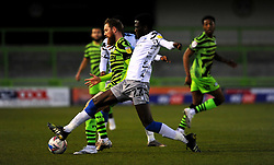 Brendan Sarpong-Wiredu of Colchester United tackles Scott Wagstaff of Forest Green Rovers- Mandatory by-line: Nizaam Jones/JMP - 27/02/2021 - FOOTBALL - The innocent New Lawn Stadium - Nailsworth, England - Forest Green Rovers v Colchester United - Sky Bet League Two