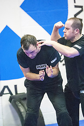 Punching during one of the exercises. Stef Noij, KMG Instructor from the Institute Krav Maga Netherlands, the IKMS G Level Programme seminar today at the Scottish Martial Arts Centre, Alloa.