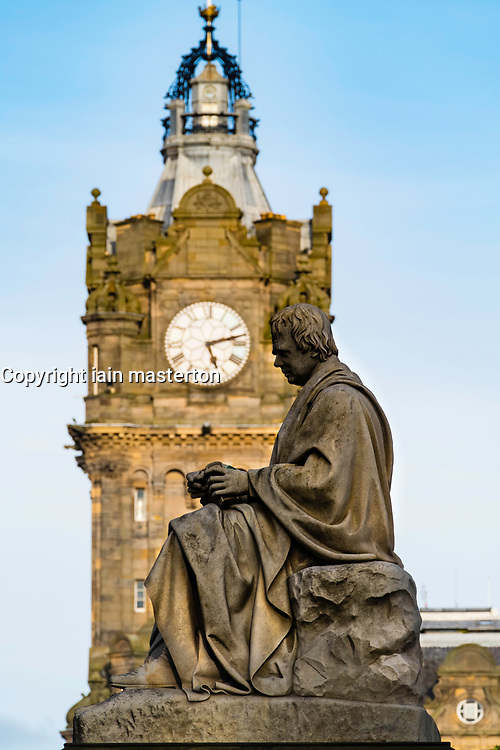 View of statue of Walter Scott with Balmoral Hotel in distance, Edinburgh, Scotland, United Kingdom,.
