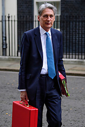© Licensed to London News Pictures. 12/12/2016. London, UK. Chancellor PHILIP HAMMOND seen leaving 11 Downing Street in London. Philip Hammond is due to  gives evidence to members of the Treasury Committee on the Autumn Statement later today (Mon). Photo credit: Ben Cawthra/LNP