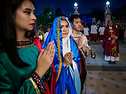 30 MARCH 2018 - BANGKOK, THAILAND: A woman representing Mary Magdelan, left, and a woman representing Mary, Jesus' mother, during Good Friday observances at Santa Cruz Church in the Thonburi section of Bangkok. Santa Cruz Church is more than 350 years old and is one of the oldest Catholic churches in Thailand. Good Friday is the day that most Christians observe as the crucifixion of Jesus Christ. Thailand has a small Catholic community.     PHOTO BY JACK KURTZ