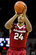 DALLAS, TX - NOVEMBER 25: Michael Qualls #24 of the Arkansas Razorbacks shoots a free-throw against the SMU Mustangs on November 25, 2014 at Moody Coliseum in Dallas, Texas.  (Photo by Cooper Neill/Getty Images) *** Local Caption *** Michael Qualls