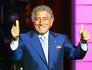 """Singer Tony Bennett thanks his fans after singing """"Who Can I Turn To"""" October 25, 2000 during the taping of """"The American Red Cross Holiday Music Spectacular from Miami"""" at The Jackie Gleason Theater in Miami Beach, Florida. The show was broadcasted on the Fox network on December 23, 2000."""