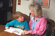 Mother age 35 discussing book with 6 year old son.  St Paul Minnesota USA