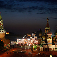 Europe, Russia, Moscow. The Kremlin, Red Square, and St. Basil's Cathedral at dusk, viewed from the Baltschug Kempinsky Hotel.
