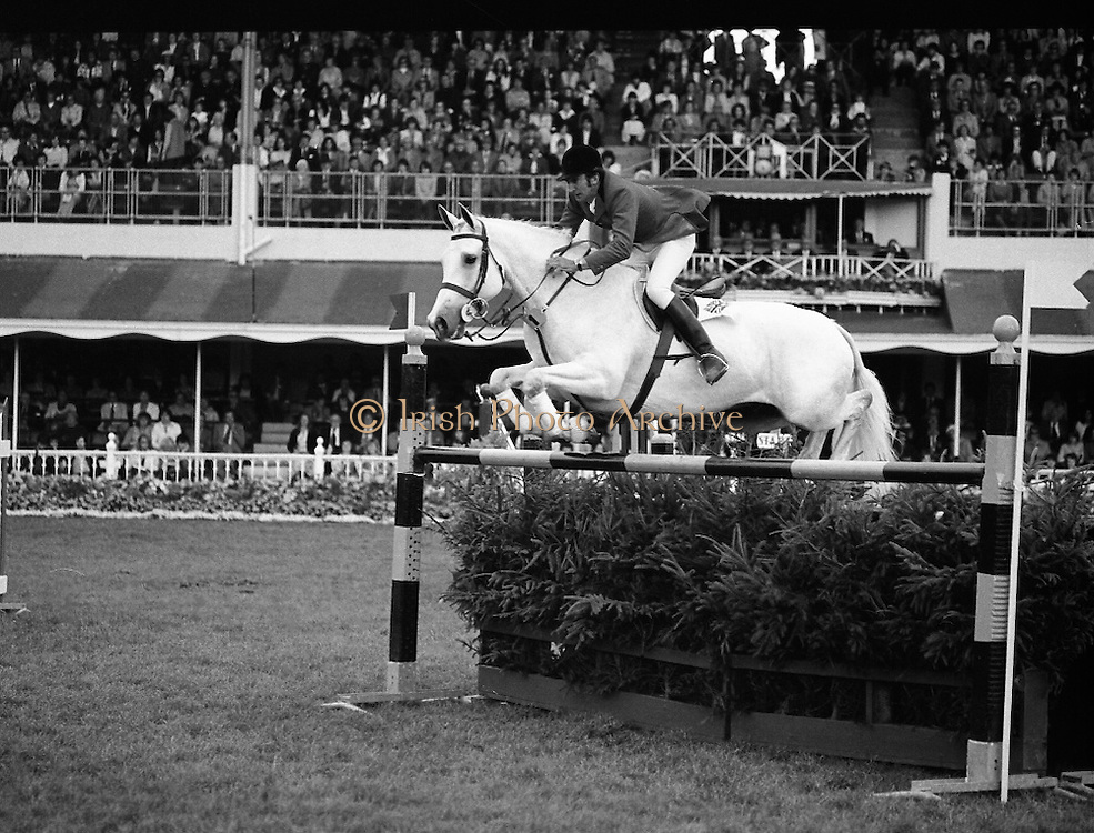Aga Khan Trophy..1979..10.08.1979..08.10.1979..10th August 1979..The annual staging of the Aga Khan Cup took place  at the Royal Dublin Showgrounds, Ballsbridge,Dublin today.It was the first time since 1937 that Ireland won the trophy outright. The winning Irish team comprised of Paul Darragh,Capt Con Power,James Kernan and Eddie Macken..A Great Britain rider takes his horse clear of this fence at the RDS.