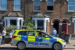 © Licensed to London News Pictures. 25/04/2020. London, UK. Forensic investigators and a police vehicle at the scene of a fatal house fire. A man has died in a house fire in Earlsfield, Wandsworth. Firefighters found the man in a ground floor bedroom. He was brought out of the property by fire crews but he died at the scene. London Fire Brigade was called at 07:36 BST and the fire was under control by 08:33 BST. Photo credit: Peter Manning/LNP
