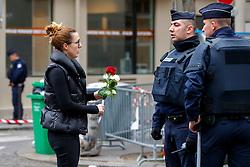 © Licensed to London News Pictures. 16/11/2015. Paris, France. Mourners visit Bataclan Cafe in Paris, France following the Paris terror attacks on Monday, 16 November 2015. Photo credit: Tolga Akmen/LNP