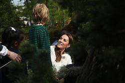 The Duchess of Cambridge speaks with a visitor during her visit to her garden at the RHS Chelsea Flower Show at the Royal Hospital Chelsea, London.