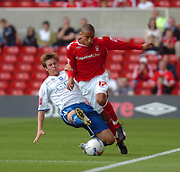 Photo: Leigh Quinnell.<br /> Nottingham Forest v Brighton & Hove Albion. Coca Cola League 1. 19/08/2006. Nottingham Forests James Perch is challenged by Brightons Dean Hammond.