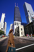 Image of a shopper on North MIchigan Avenue along the Magnificent Mile in Chicago, Illinois, American Midwest, model released by Randy Wells