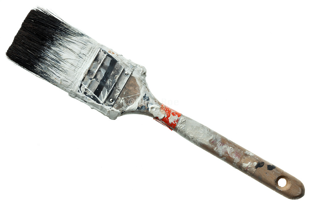 used paint brush with white paint