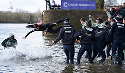 Cambridge Men's Blue Boat cox Ian Middleton (second left) and Oxford Women's Blue Boat cox Rosemary Ostfeld (left) are thrown into the river Thames as the two crews celebrate their victories in the respective Boat Races on the River Thames, London.