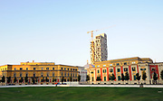A new skyscraper rises above the ministry buildings surrounding  Skanderbeg Square, Tirana, Albania. 02Sep15