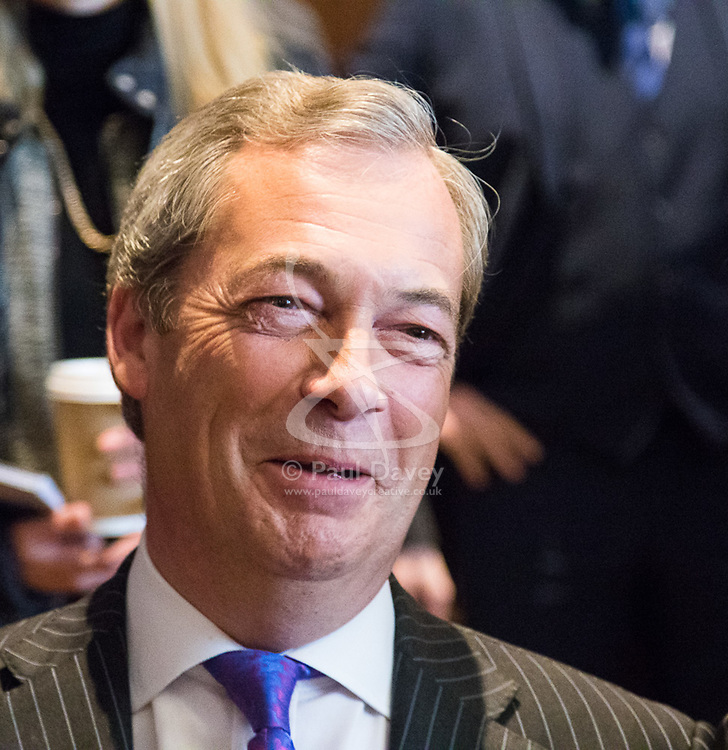 """Westminster, London, March 27th 2017. Ahead of the Prime Minister triggering Article 50 next week, UKIP Leader Paul Nuttall sets out six key tests by which the country can judge Theresa May's Brexit negotiations in a keynote speech in London. PICTURED: Nigel Farage attended the event insisting """"I'm just a visitor"""". CREDIT: ©Paul Davey<br /> <br /> ©Paul Davey<br /> FOR LICENCING CONTACT: Paul Davey +44 (0) 7966 016 296 paul@pauldaveycreative.co.uk"""