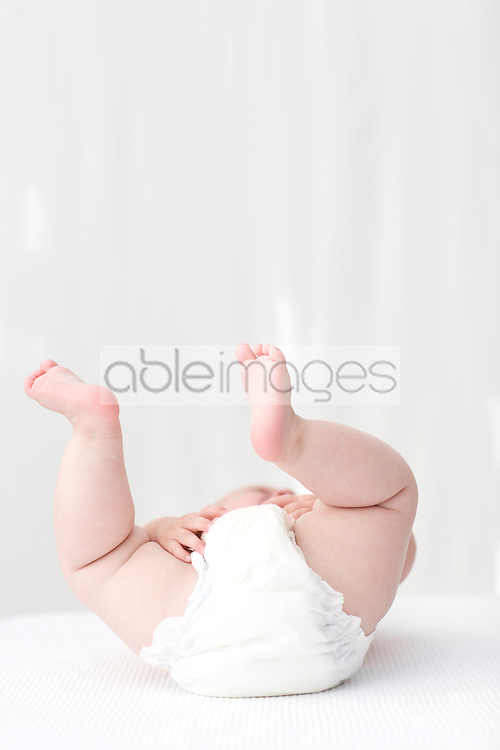 Close up of baby's feet lying on  back