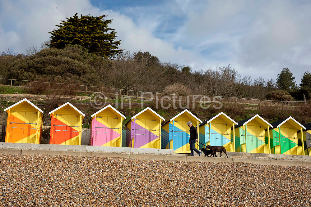 Colourful new beach huts called No.1054 Arpeggio by artist Rana Begum are part of the Folkestone Triennial 2021 along the seafront on 14th of March 2021 in Folkestone, United Kingdom. The art installation was a collaboration between Folkestone and Hythe District Council and Creative Folkestone Triennial 2021 that refurbished more than 100 beach huts along Folkestone seafront, the artist work unites geometry, light and colour bringing one of the largest and most joyful artworks in the country to Kent.